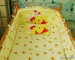 Бортики для детской кроватки: полезные функции